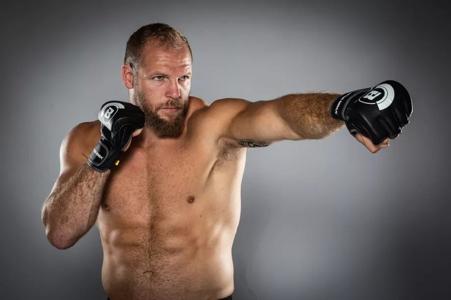 Haskell, 34, hung up his boots after struggling to overcome recurring ankle and toe problems after decorated rugby career that included winning 77 caps for his country. Pic courtesy of mmafighting.com