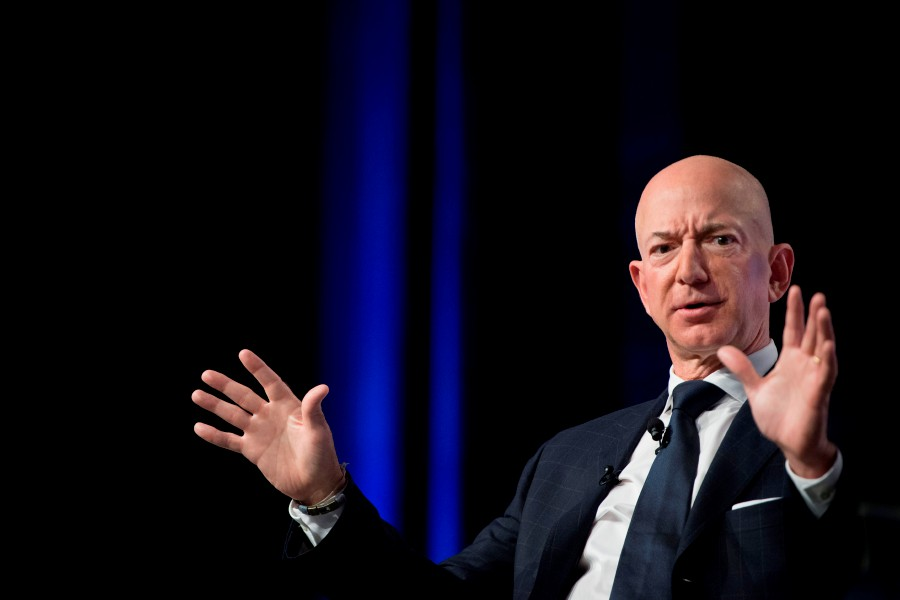 """In this file photo taken on September 19, 2018 Amazon and Blue Origin founder Jeff Bezos provides the keynote address at the Air Force Association's Annual Air, Space & Cyber Conference in Oxen Hill, MD. - Amazon CEO Jeff Bezos on February 7, 2019 accused the publisher of the National Enquirer of """"blackmail"""" after it threatened to publish intimate photographs sent by the billionaire to his mistress. AFP"""