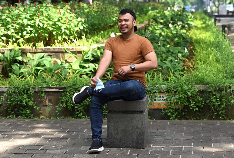 This picture taken on November 28, 2020 shows Juno Simorangkir, a Long Covid campaigner, posing at a park in Jakarta. - AFP pic