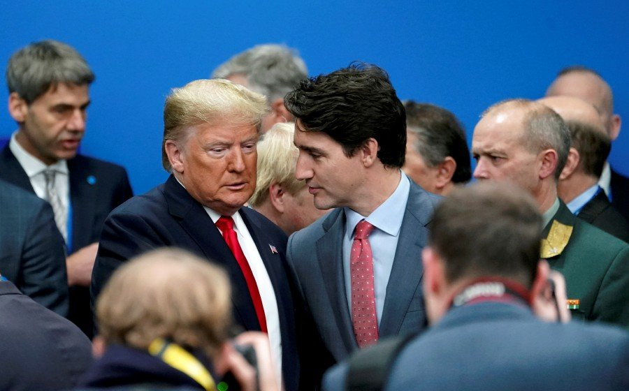 U.S. President Donald Trump talks with Canada's Prime Minister Justin Trudeau during a North Atlantic Treaty Organization Plenary Session at the NATO summit in Watford. -Reuters