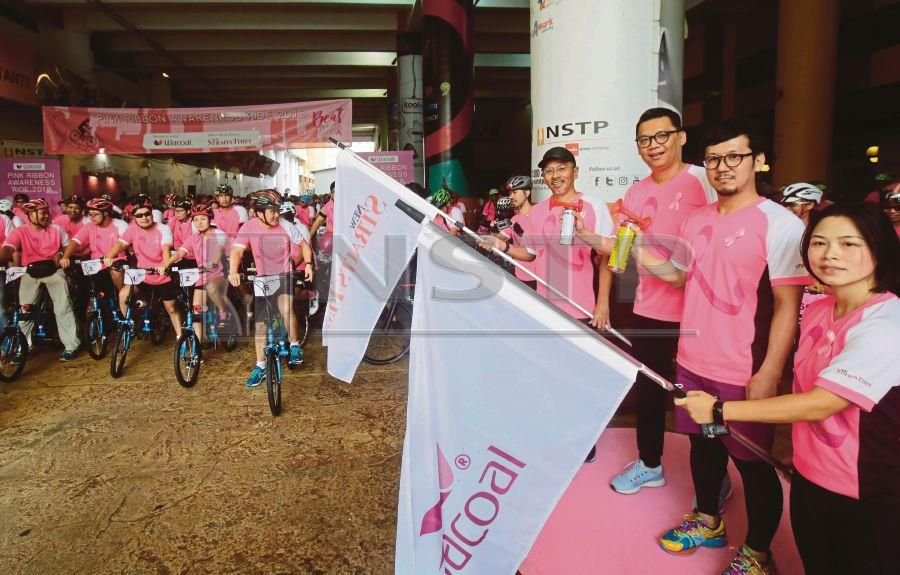Clad in vibrant pink jerseys bearing the slogan 'Because We Care', the riders powered through a 25km route which began and ended at the New Straits Times Press (M) Bhd (NSTP) Balai Berita headquarters at Jalan Riong, Bangsar. (NSTP/SYARAFIQ ABD SAMAD)