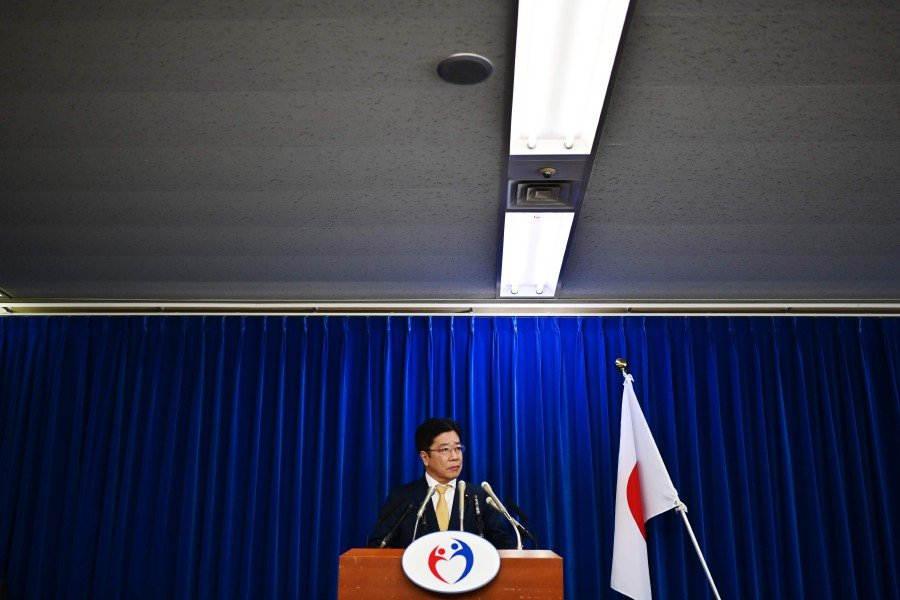 Japan's Health Minister Katsunobu Kato speaks during a press conference on the COVID-19 coronavirus at the ministry in Tokyo. -AFP