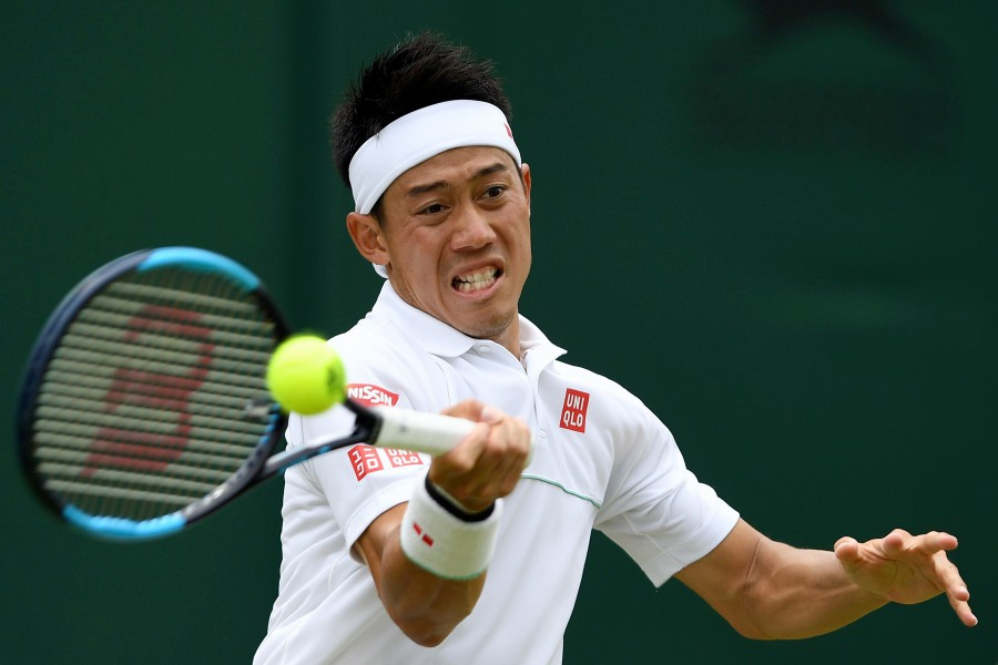 Japan's Kei Nishikori returns against US player Steve Johnson during their men's singles third round match on the sixth day of the 2019 Wimbledon Championships at The All England Lawn Tennis Club in Wimbledon, southwest London. - AFP