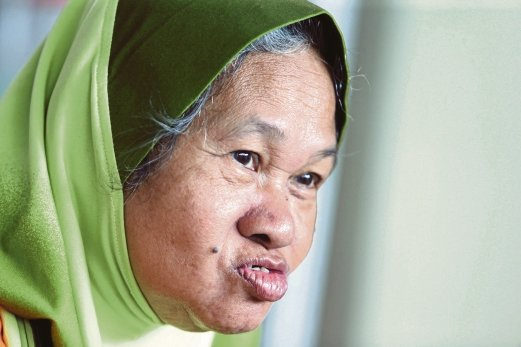 Mak Long is glad for the simple Raya celebrations at the home