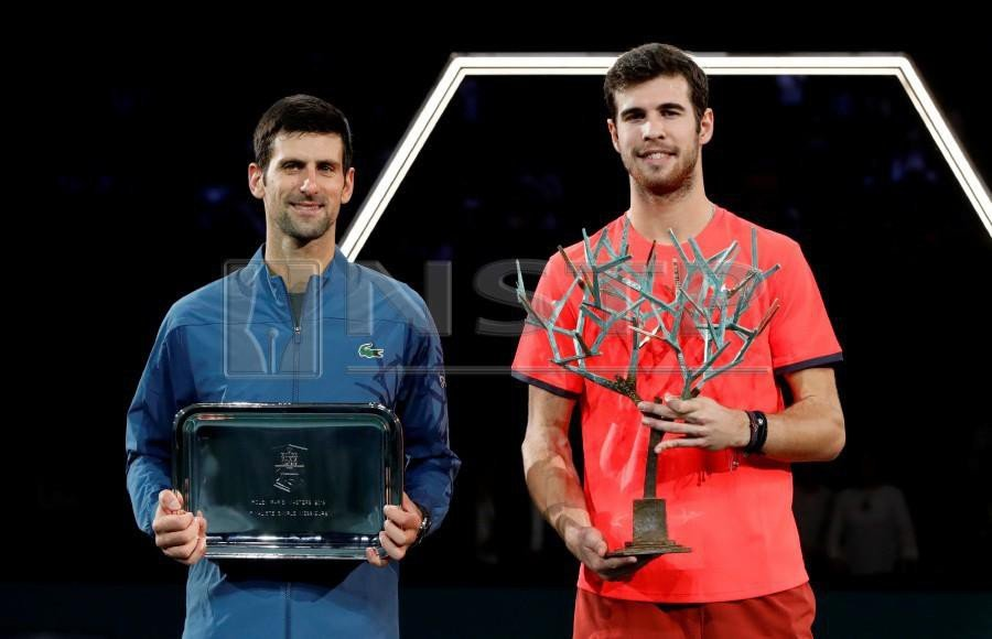 Karen Khachanov of Russia (right) with the winners trophy alongside runner up Novak Djokovic of Serbia after the final. - Reuters