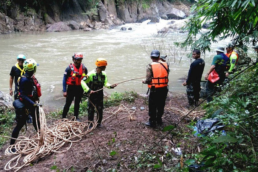 """This handout from Thailand's Department of National Parks, Wildlife and Plant Conservation taken and released on October 9, shows rescuers at the site of a waterfall known as """"Hell's Abyss"""" in Khao Yai National Park, where 11 elephants fell to their death. -AFP/Department of National Parks, Wildlife and Plant Conservation"""
