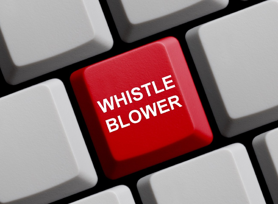 what is whistleblowing in ethics