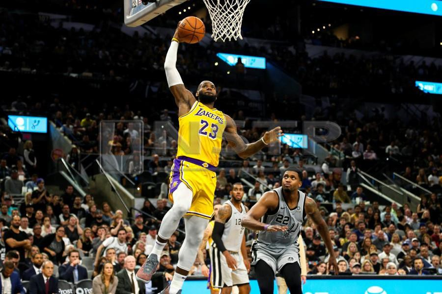 cheap for discount 81d2e 72d9f Los Angeles Lakers forward LeBron James (23) goes up for a dunk during the  fourth quarter against the San Antonio Spurs at AT T Center.