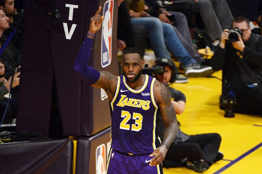 f0ab407c84c3 LeBron James of the Los Angeles Lakers celebrates after passing Michael  Jordan and moving to No 4 on the NBA s all-time scoring list during the  second ...