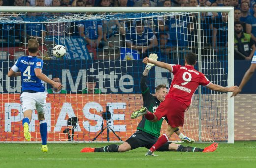 Bayern's Robert Lewandowski (right) scores the opening goal against FC Schalke 04 in Gelsenkirchen. EPA