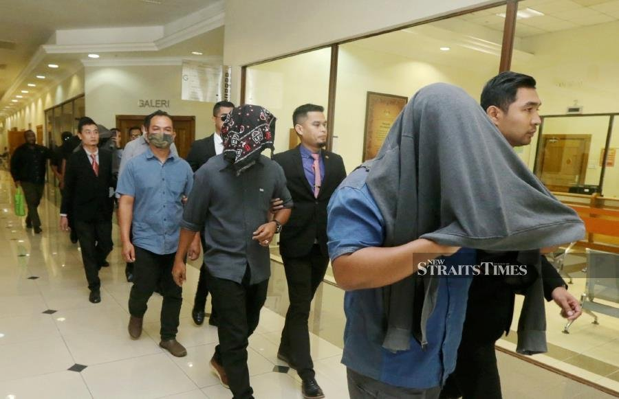 The seven accused, attached to the marine police intelligence unit, pleaded not guilty after the two charges were read out to them by a court interpreter in the packed Sessions Court. -NSTP/ZULKEPLI OSMAN