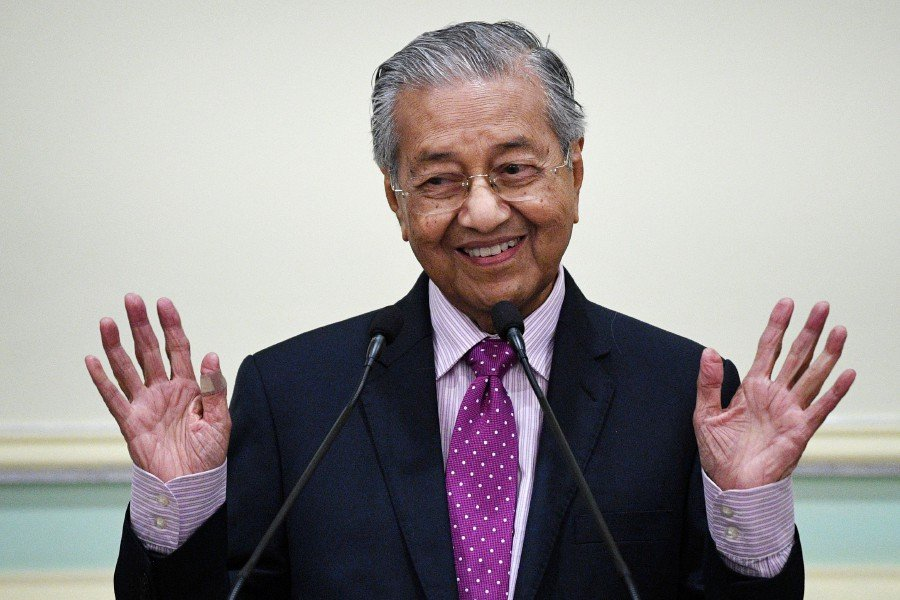 Tun Dr Mahathir Mohamad speaking at a press conference after announcing the 2020 Economic Stimulus Package in Putrajaya today. - AFP pic