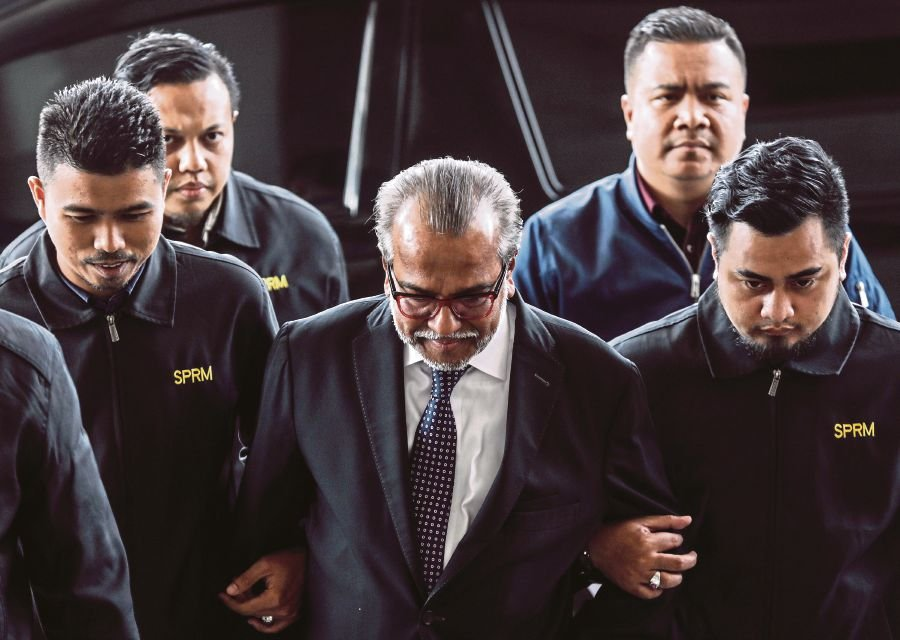 Prominent lawyer Tan Sri Shafee Abdullah was charged with two counts of money laundering at the sessions court at Jalan Duta here today. (EPA photo)