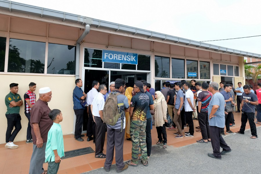 Family and friends of the late Mohamad Amir Izzudin at the Forensic Unit of the Dungun Hospital today. - Bernama pic