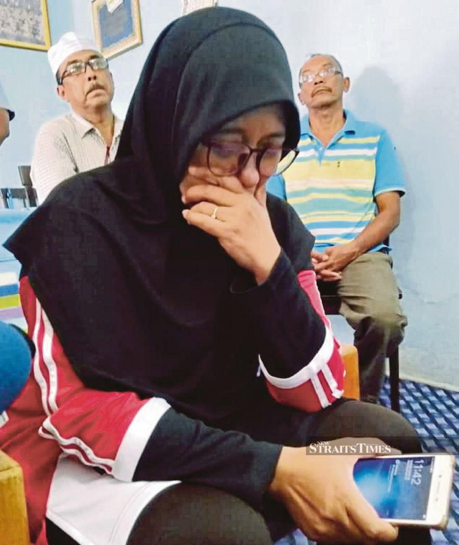 it is understood that Mohd Tarmizi's sister Mariani (pic), 49, and his cousin Nordiana Ahmad Fauzi would leave for Christchurch latest by tomorrow. Pic by STR/ZULIATY ZULKIFFLI