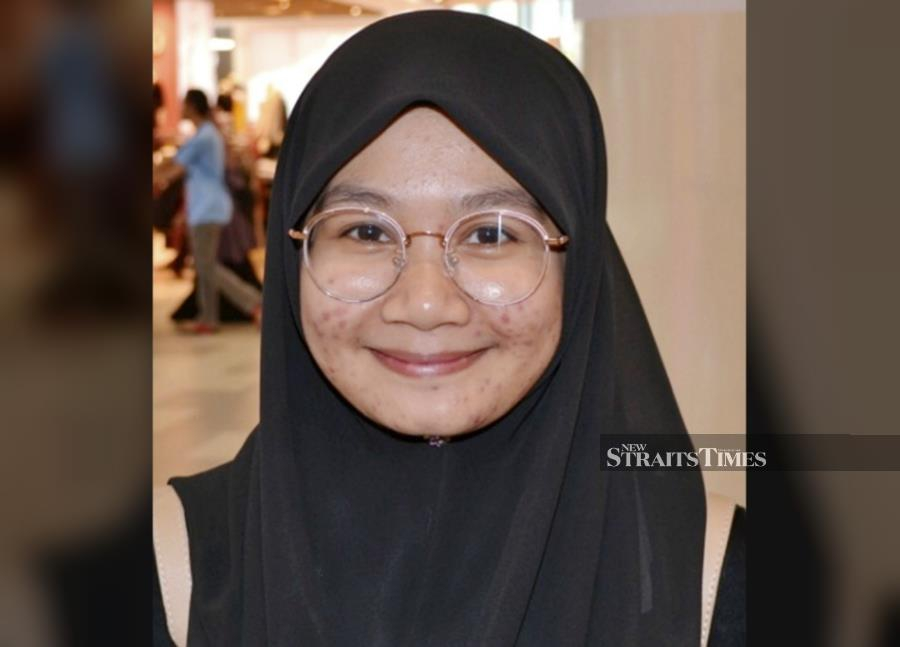 Cashier Martiza Ali is planning to own a property but just like other first-time house buyers, she remains cautious. - STR/ASROL AWANG