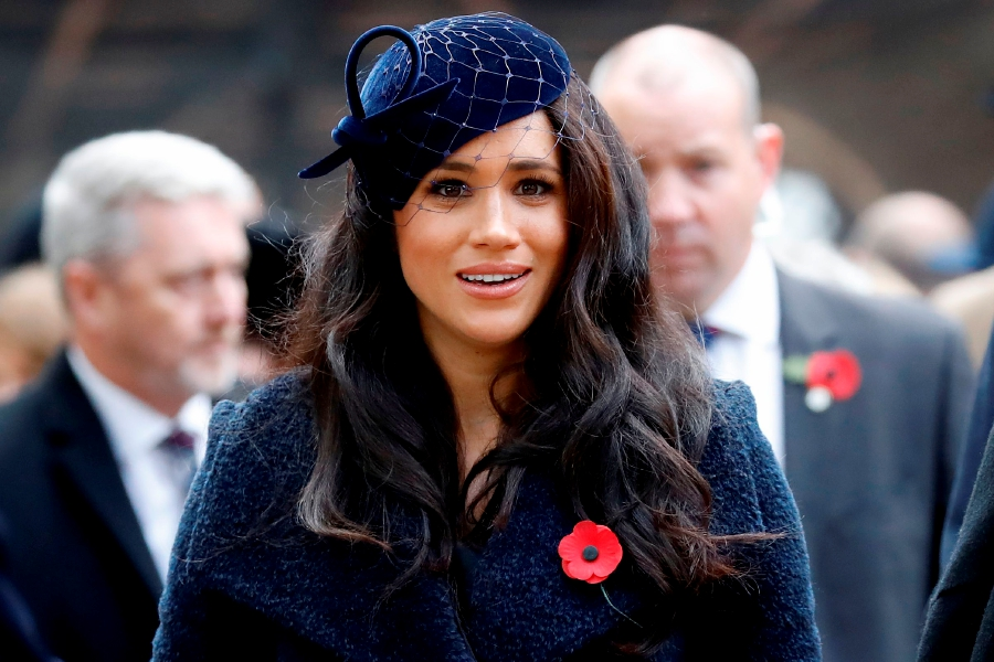 (FILES) In this file photo taken on November 07, 2019 Meghan, Duchess of Sussex leaves after paying her respects during a visit to the Field of Remembrance at Westminster Abbey in central London on November 7, 2019. - Prince Harry's wife Meghan will make an instant start to life away from Britain's royal frontline by narrating a new film about a family of African elephants, Disney announced on Thursday. (Photo by Tolga AKMEN / AFP)