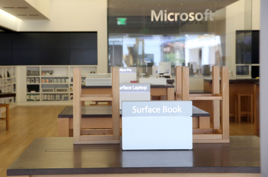 The showroom at Microsoft store sits empty on June 26, 2020 in Corte Madera, California. Microsoft announced that it plans to close all of its 83 brick-and-mortar stores and switch to an online only platform. The company says it will keep their New York City, London, Redmond, Washington and Sydney, Australia storefronts open to showcase their technology but not to sell their products.   Justin Sullivan/Getty Images/AFP