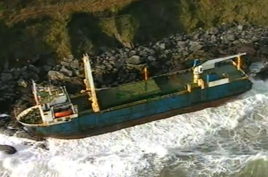 A handout still image take from footage released by the Irish Coast Guard on February 17, and recorded on February 16, shows the abandoned MV Alta cargo ship on the rocks off the coast of Ballycotton near Cork in Ireland. -AFP/Irish Coast Guard