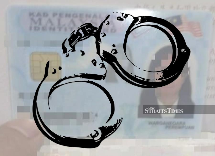 Two illegal immigrants who attempted to apply for new MyKad using the identity of dead people have been arrested by police. - NSTP File pic