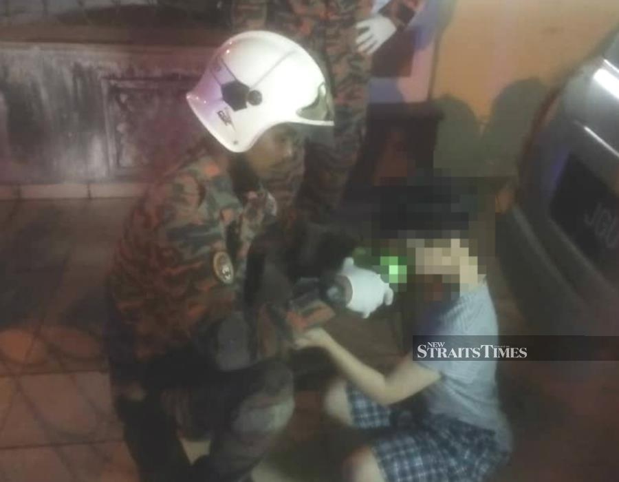 A woman was found dead in her home at Taman Impian Emas here, this morning; while her low-functioning disabled 12-year-old son was discovered on the verge of starvation in one of the bathrooms of the house. - NSTP/ Courtesy of JBPM