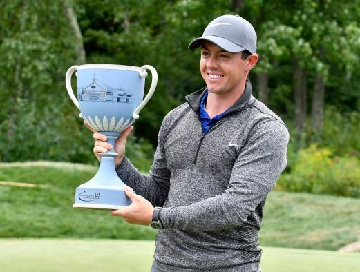 Rory McIlroy holds the trophy after winning the 2016 Deutsche Bank Championship golf tournament at TPC of Boston. Pix by Mark Konezny-USA TODAY Sports