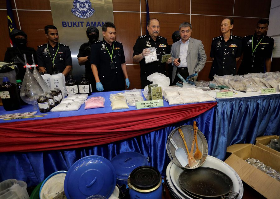 (File pix) Bukit Aman Narcotics Crime Investigation Department director Commissioner Datuk Seri Mohd Mokhtar Mohd Shariff announcing the seizure of drugs recently. Law enforcement should be focused on 'big fish' who produce and distribute drugs so that more resources are available for drug rehabilitation. Pix by Aizuddin Saad