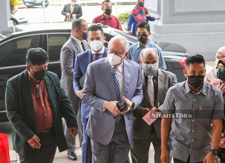 The Court of Appeal has allowed a temporary stay of a judgment which ordered Datuk Seri Najib Razak (centre) and his son Datuk Mohd Nazifuddin to pay RM1.69 billion and RM37.6 million respectively in tax arrears. - NSTP/ASWADI ALIAS.