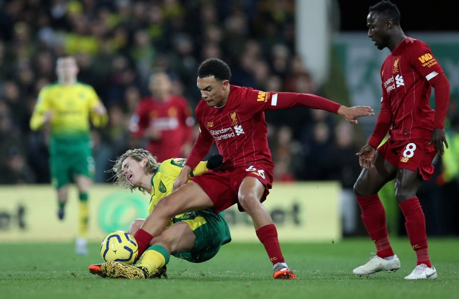 Premier League - Norwich City v Liverpool - Carrow Road, Norwich, Britain - February 15, 2020 Norwich City's Todd Cantwell in action with Liverpool's Trent Alexander-Arnold and Naby Keita. - REUTERS/Chris Radburn