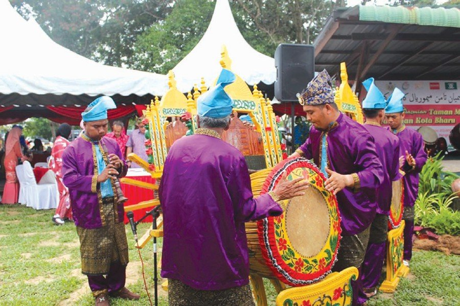 Guests being treated to Rebana Ubi, a traditional Kelantanese performance usually played during official ceremonies.