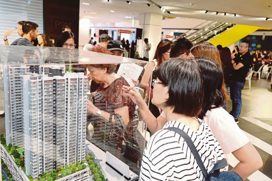 Visitors looking at the scale model of 121 Residences. GLOMAC PIC