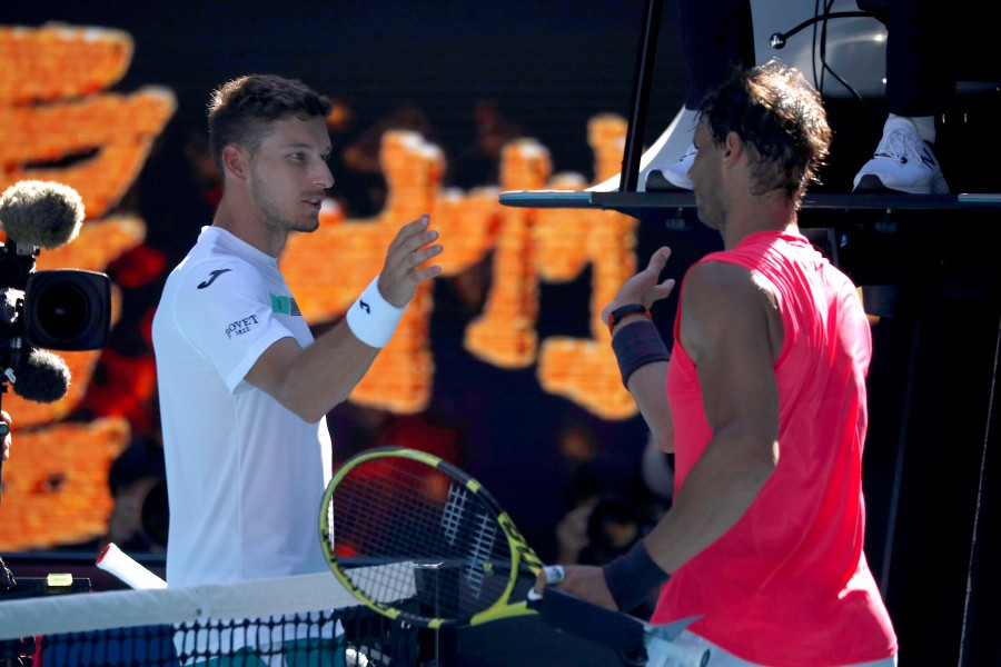 Spain's Rafael Nadal and Spain's Pablo Carreno Busta shake hands after their match. -Reuters