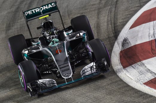 276df8cc108 Mercedes AMG Petronas F1 Team s German driver Nico Rosberg takes a corner  during the qualifying session in Singapore on September 17