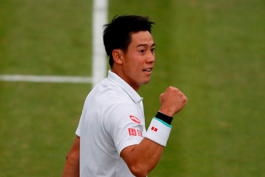 Japan's Kei Nishikori celebrates beating Kazakhstan's Mikhail Kukushkin during their men's singles fourth round match on the seventh day of the 2019 Wimbledon Championships at The All England Lawn Tennis Club in Wimbledon, southwest London. - AFP