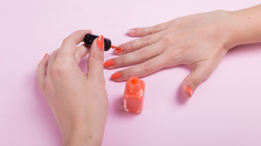 Dab a layer of Vaseline around your nail bed and paint.Photo from Freepik.com.