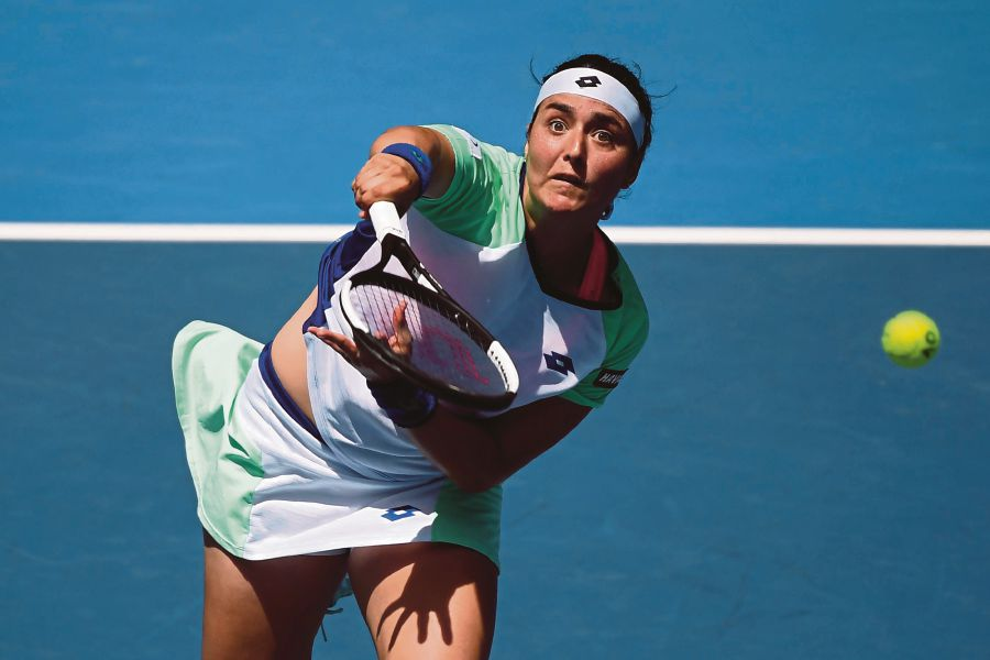 Tunisia's Ons Jabeur hits a return against Sofia Kenin of the US during their women's singles match on day nine of the Australian Open tennis tournament in Melbourne on January 28, 2020. (Photo by Manan VATSYAYANA / AFP)
