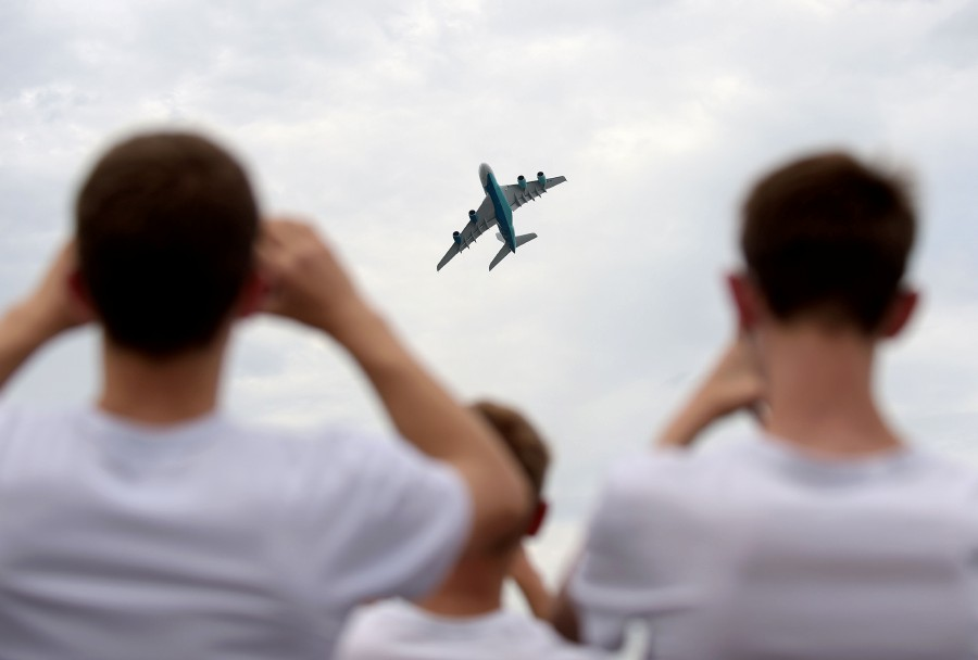 (FILES) In this file photo taken on June 23, 2019 an Airbus A380 of the Portuguese company Highfly performs a flying display on the last day of the International Paris Air Show at Le Bourget Airport, near Paris. - The 2021 edition of Paris Air Show is cancelled, organisers announced on December 7, 2020. (Photo by ERIC PIERMONT / AFP)