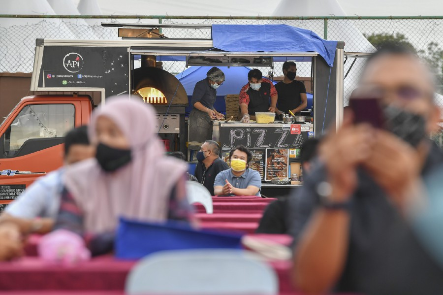 59,602 inspections were conducted by the task force on SOP compliance at various public places yesterday. - Bernama file pic, for illustration purposes only