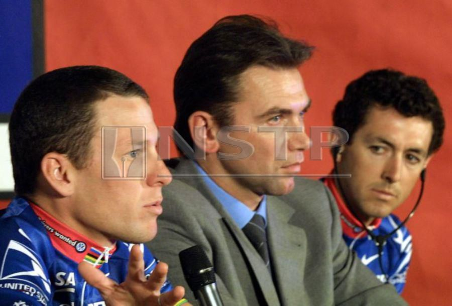 Former US Postal team manager Johan Bruyneel (centre) has been handed a life ban from cycling by the Court of Arbitration for Sport. AFP FILE PIX