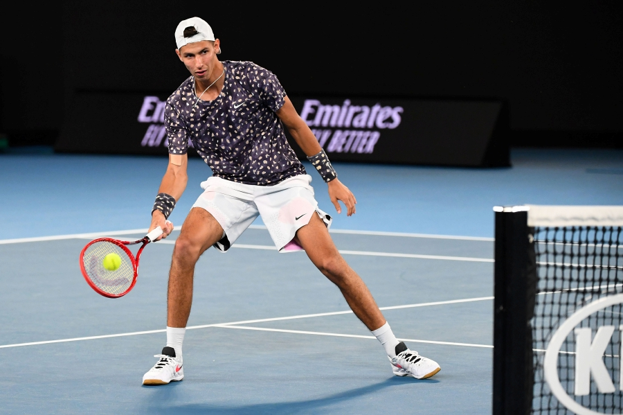 Australia's Alexei Popyrin hits a return against Russia's Daniil Medvedev during their men's singles match on day six of the Australian Open tennis tournament in Melbourne on January 25, 2020. (Photo by William WEST / AFP)