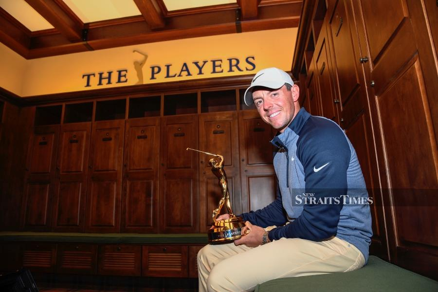 Rory McIlory of Northern Ireland with THE PLAYERS Championship trophy after the final round at TPC Sawgrass on March 17, 2019. PGA TOUR pic.