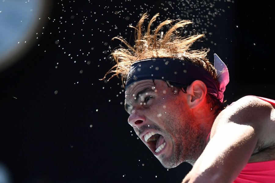 Spain's Rafael Nadal serves against Spain's Pablo Carreno Busta during their men's singles match on day six of the Australian Open tennis tournament in Melbourne on January 25, 2020. (Photo by William WEST / AFP)