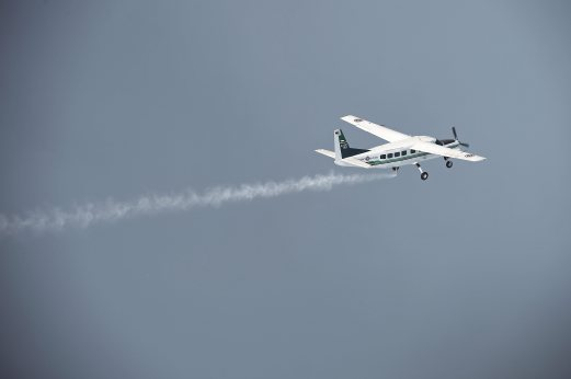 This picture taken on March 25, 2016 shows a pair of Cessna 208 Caravan aircraft from the Thai Department of Royal Rainmaking depositing a sodium chloride-based material above clouds in Nakhon Sawan in an effort to produce rain. Thailand's prime minister last week told farmers to cultivate less rice to help the country manage its intensifying water crisis, as experts called this year's drought the worst in decades. Water reserves across the country have dipped below last year's levels, which were already considered a record low, according to the irrigation department. AFP Photo