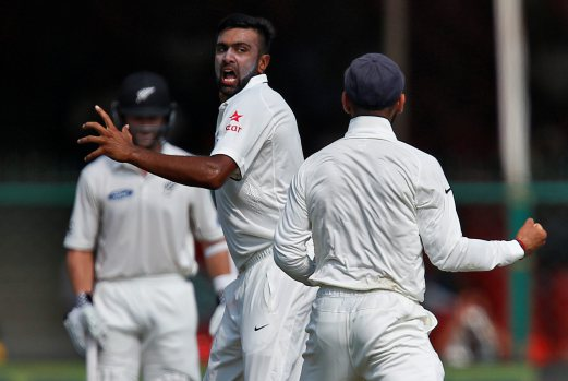 India's Ravichandran Ashwin celebrates after taking the wicket of New Zealand's Tom Latham. REUTERS