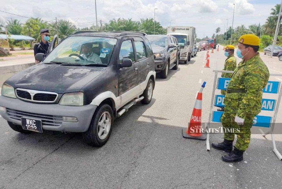 Business operators who have to travel with more than 2 in a vehicle are told to get police permission. - NSTP file pic