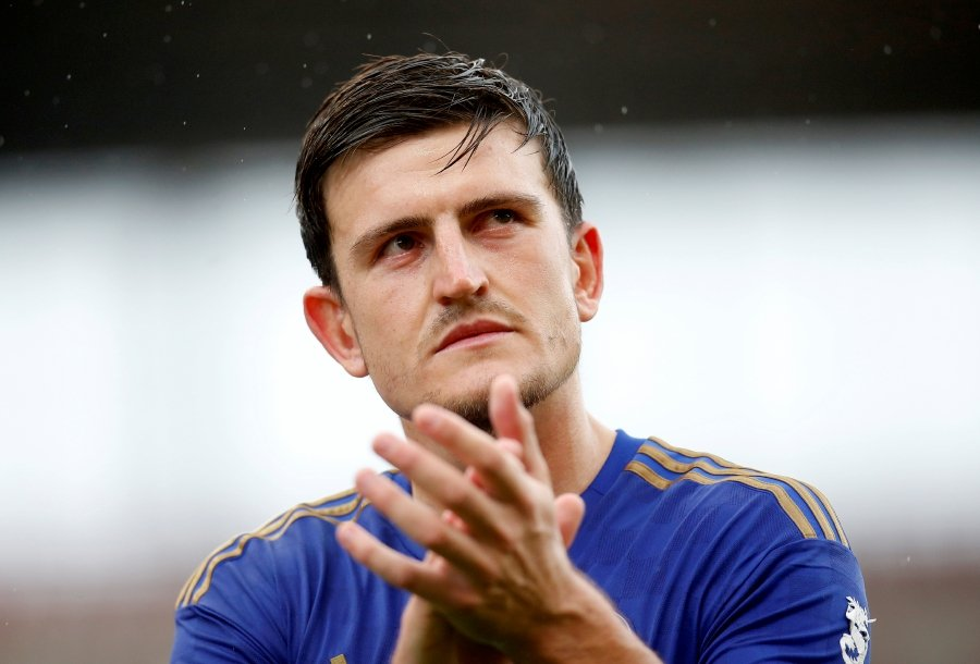 FILE PHOTO: Soccer Football - Pre Season Friendly - Stoke City v Leicester City - bet365 Stadium, Stoke-On-Trent, Britain - July 27, 2019 Leicester City's Harry Maguire applauds fans after the match. - Action Images via Reuters/Ed Sykes/File Photo