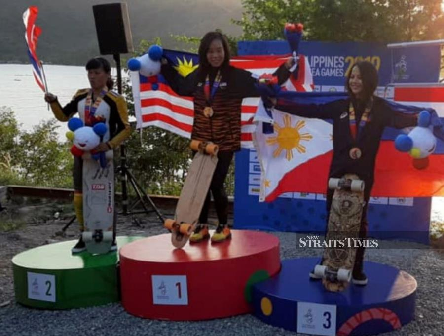 National skateboard athlete Grace Wong Sze Ern pulled off an upset to claim gold for Malaysia in the women's downhill event at the 30th SEA Games today. NSTP/pix courtesy of reader
