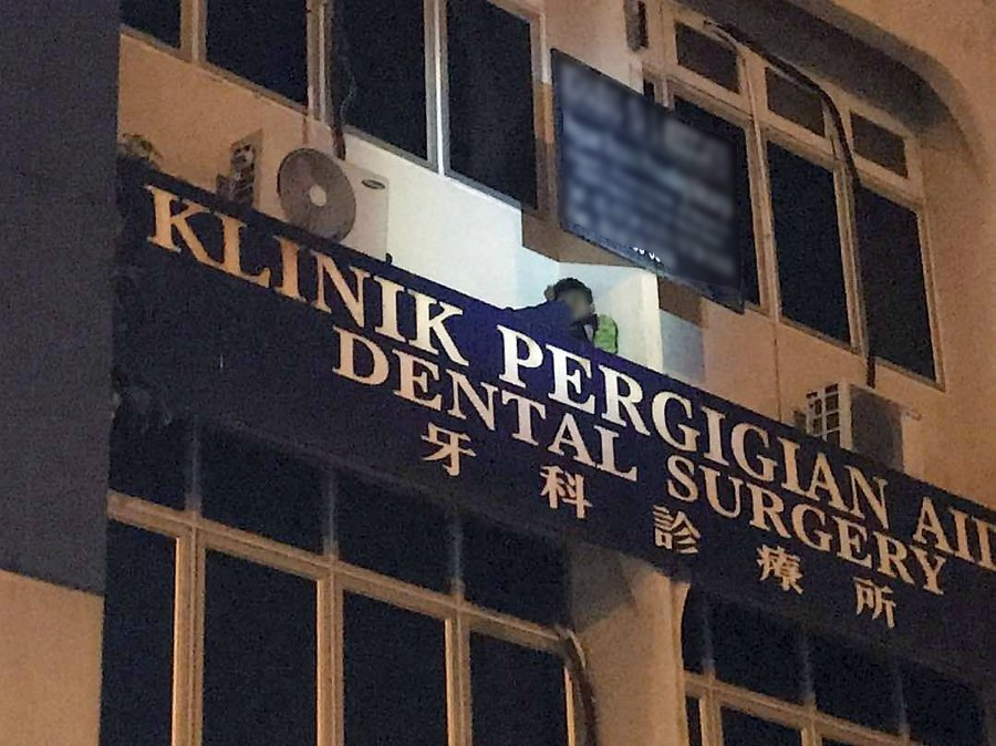 Foreigner who hid on signboard after killing woman nabbed