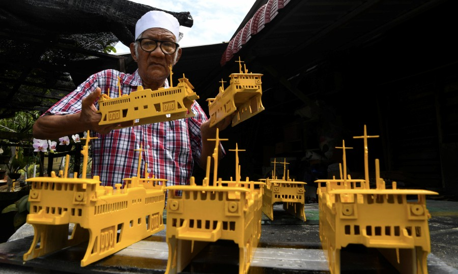 Zainol Abidin Omar may be a septuagenarian, but his passion for wood carving makes him wants to continue to produce intricate carvings on models of the various icons of Penang such as the ferry, Penang bridge and the Bukit Bendera train. - Bernama pic