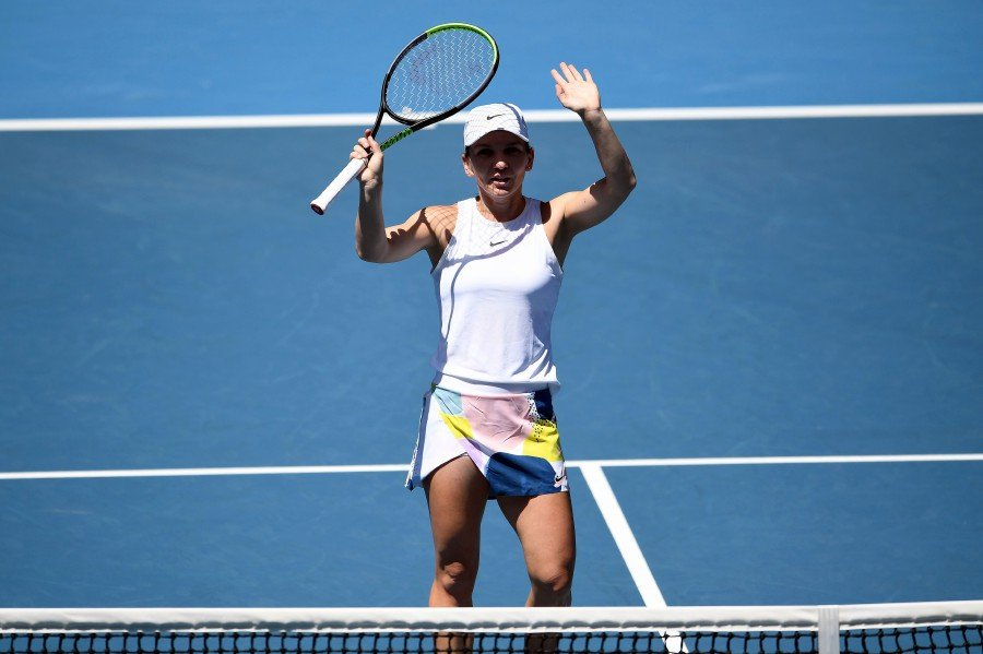 Romania's Simona Halep celebrates after victory against Estonia's Anett Kontaveit during their women's singles quarter-final match on day ten of the Australian Open tennis tournament in Melbourne. -AFP